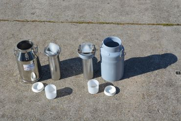 Milk cans with ice compartment.JPG