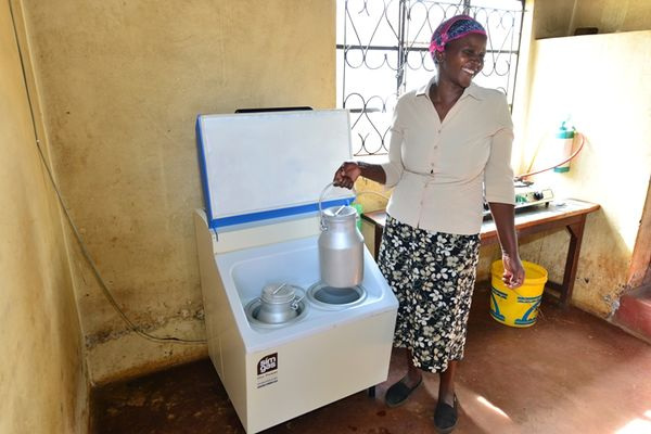Biogas Cooling in Kenya-Woman with milk cans.JPG