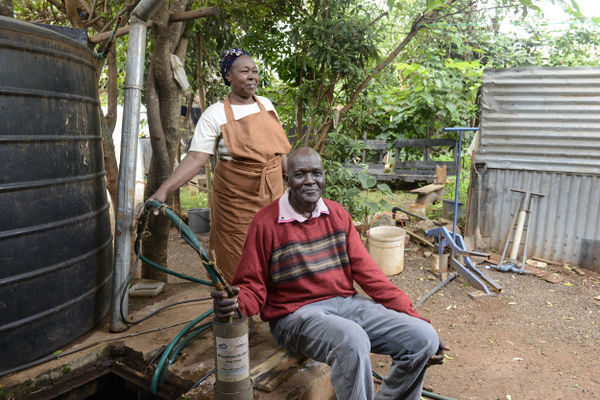 Water Tank in Kenya with man and woman.jpg