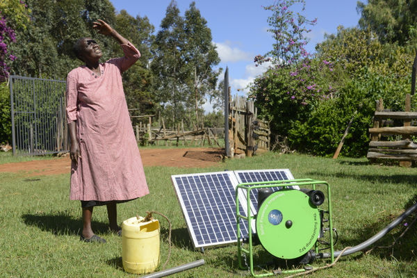 Futurepump in Kenya. Woman looking up towards the sky.jpg